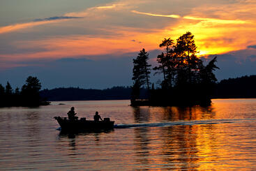 Fishermen on a Boat in the Water with Pretty Sky